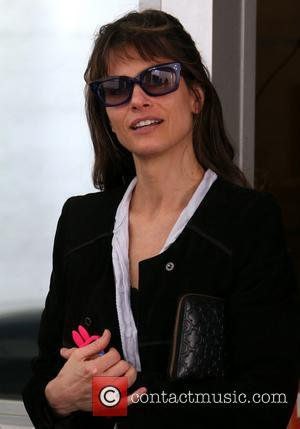 Amanda Peet - Amanda Peet out and about wearing a crumpled shirt with a black jacket on Brighton Way in...