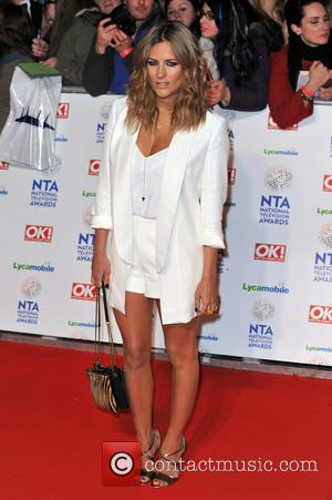 Caroline Flack - The National Television Awards 2014 (NTA's) held at the O2 Arena - Arrivals - London, United Kingdom...