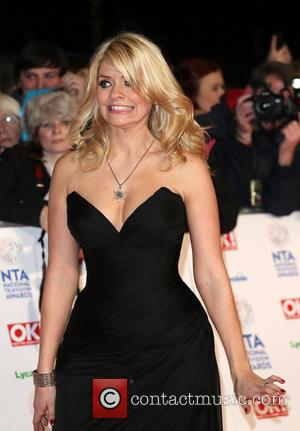 Holly Willoughby - The National Television Awards 2014 (NTA's) held at the O2 Arena - Arrivals - London, United Kingdom...