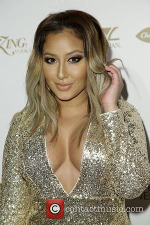 Adrienne Bailon - OK! Magazine's pre-Grammy event with a performance by Jason Derulo and special guest appearance by Jordin Sparks...