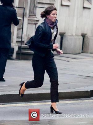 Milla Jovovich - Milla Jovovich films a running scene for her new film 'Survivor' - London, United Kingdom - Saturday...