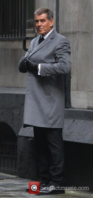 Pierce Brosnan - Pierce Brosnan and Milla Jovovic film scenes for the new action movie Survivor in London - London,...