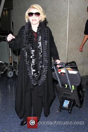 Joan Rivers - Joan Rivers arrives at Los Angeles International (LAX) airport - Los Angeles, California, United States - Saturday...