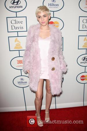 Miley Cyrus - 2014 Pre-Grammy Gala & Grammy Salute to Industry Icons - Clive Davis at The Beverly Hilton Hotel...