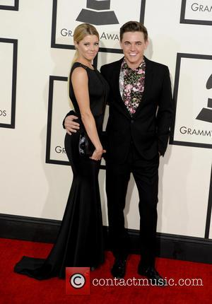 Jesse McCartney and Katie Peterson - 56th GRAMMY Awards - Arrivals - Los Angeles, California, United States - Sunday 26th...