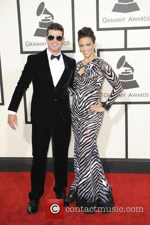 Robin Thicke and Paula Patton