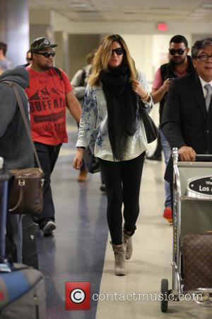 Daisy Fuentes - Daisy Fuentes arriving at Los Angeles International Airport (LAX) wearing a mono Tie-dye top and scarf -...