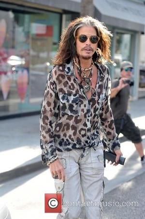 Steven Tyler - Steven Tyler is seen shopping for new sunglasses in beverly hills. his hair is showing a bit...