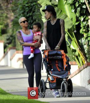 amber rose and Wiz Khalifa - American rapper Wiz Khalifa takes his wife and son Sebastian on a hike to...