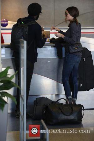 gary clark jr - Gary Clark Jr with girlfriend Nicole Trunfio at checking in at Los Angeles International Airport (LAX)...