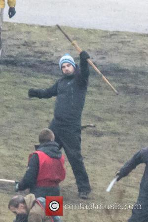 Michael Fassbender - Michael Fassbender is seen practising a battle scene with extras on the set of the new movie...