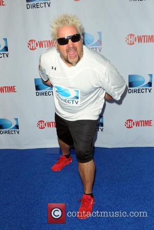 Guy Fieri - DirecTV's 8th Annual Celebrity Beach Bowl held at Pier 40 - Arrivals - New York City, New...