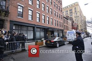 The body of Philip Seymour Hoffman removed from his apartment building in a black body bag just before 7 p.m....