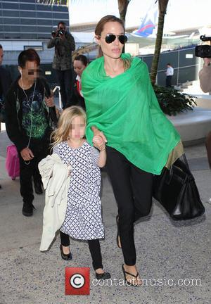 Maddox Chivan Jolie-Pitt, Angelina Jolie and Vivienne Marcheline Jolie-Pitt