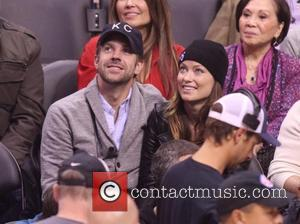 Jason Sudeikis and Olivia Wilde - Wednesday February 5, 2014; Celebs out at the Clippers-Heat game. The Miami Heat defeated...