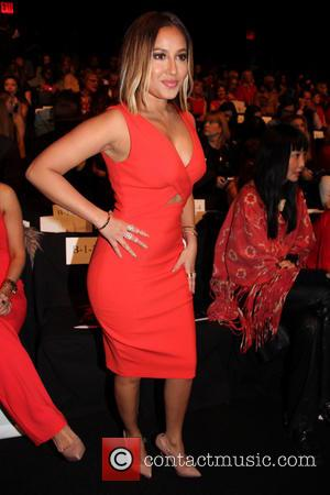 Adrienne Bailon - New York Fashion Week - Go Red For Women - The Heart Truth Red Dress Collection 2014...