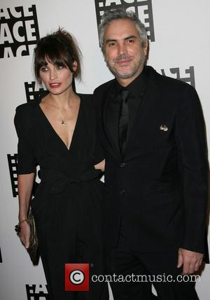 Director Alfonso Cuaron and Sheherazade Goldsmith - 64th Annual Ace Eddie Awards held at the Beverly Hilton Hotel in Beverly...