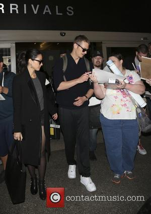 Olivia Munn and Joel Kinnaman - Olivia Munn and Joel Kinnaman sign autographs for waiting fans as they arrive at...