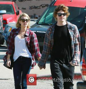 Emma Roberts and Evan Peters - American Horror Stories Stars Emma Roberts and Evan Peters walk to a Shop in...