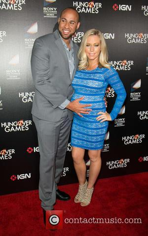 Hank Baskett and Kendra Wilkinson - Premiere of 'The Hungover Games' held at TCL Chinese 6 Theatres - Arrivals -...