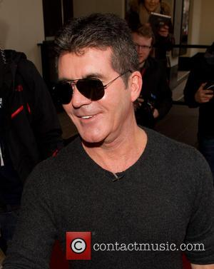 Simon Cowell Disccuses More Children In The Future In First Interview Since Baby Eric's Birth