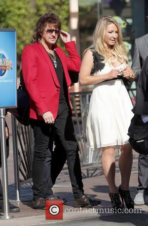 Richie Sambora and Nikki Lund - Richie Sambora and Nikki Lund appear on 'Extra' held at Universal CityWalk - Los...