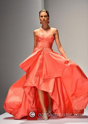 Model - Models walk the down the runway during an Oscar De La Renta fashion show in aid of a...