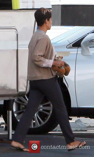 Halle Berry - Halle Berry's bodyguard is spotted holding her son, Maceo Robert Martinez, in a baby car seat on...