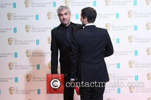 Alfonso Cuaron and David Heyman - EE British Academy Film Awards (BAFTA) 2014 held at the Royal Opera House -...