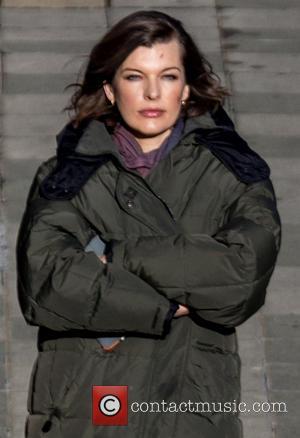 Milla Jovovich - Milla Jovovich films scenes for new film 'Survivor' in a London subway - London, United Kingdom -...