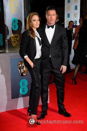 Angelina Jolie and Brad Pitt - EE British Academy Film Awards (BAFTA) 2014 held at the Royal Opera House -...