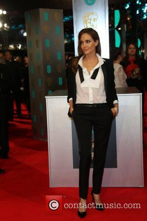 Angelina Jolie And Brad Pitt Go Matchy-Matchy And Reveal Hidden Tinie Tempah Love At BAFTAs
