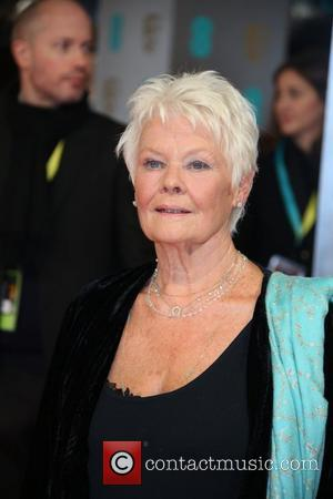 Judi Dench - EE British Academy Film Awards (BAFTA) 2014 held at the Royal Opera House - Arrivals - London,...