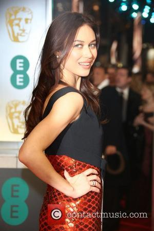 Olga Kurylenko - EE British Academy Film Awards (BAFTA) 2014 held at the Royal Opera House - Arrivals - London,...