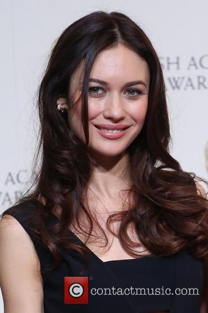 Olga Kurylenko - British Academy Film Awards (BAFTA) 2014 held at the Royal Opera House - Press Room - London,...
