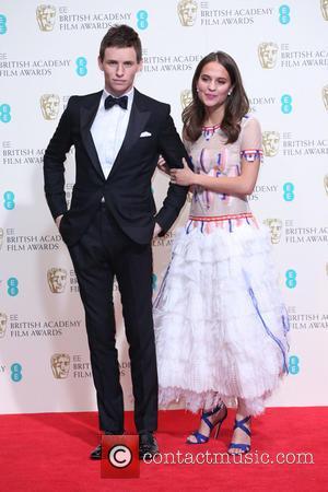 Eddie Redmayne and Alicia Vikander - British Academy Film Awards (BAFTA) 2014 held at the Royal Opera House - Press...