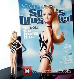 Barbie - The SI (Sports Illustrated) Swimsuit Edition Barbie doll at the 111th American International Toy Fair: TOY FAIR 2014....