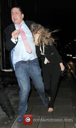Cara Delevingne - Cara Delevingne is rushed into her hotel by her bodyguard. Cara appeared rather worse for wear, with...