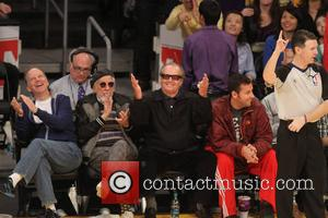 Adam Sandler and Jack Nicholson - Celebrities at the Lakers game.The Houston Rockets defeated the Los Angeles Lakers by the...