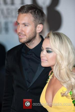 Calvin Harris and Rita Ora - The Brit Awards (Brit's) 2014 held at the O2 - Arrivals - London, United...