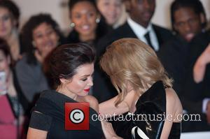 Dannii Minogue and Kylie Minogue - The Brit Awards (Brit's) 2014 held at the O2 - Arrivals - London, United...