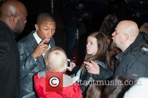 Pharrell Williams - Pharrell Williams gets into an argument with an autograph hunter after not spotting a young fan waiting...
