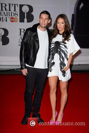 Example and Elliot John Gleave - The Brit Awards (Brit's) 2014 held at the O2 - Arrivals - London, United...