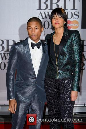 Pharrell Williams and Helen Lasichanh - The Brit Awards (Brit's) 2014 held at the O2 - Arrivals - London, United...