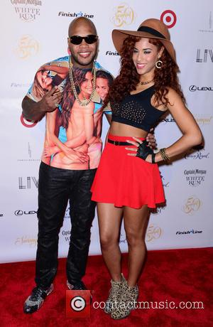 Flo Rida and Natalie la Rose - Sports Illustrated models attends Club SI Swimsuit at LIV Nightclub hosted by Sports...