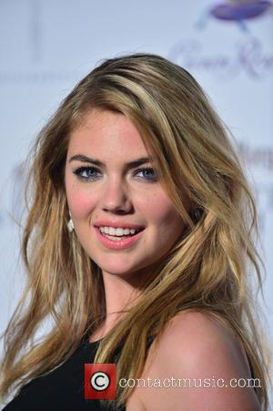Kate Upton - Sports Illustrated Hosts Club SI Swimsuit At...