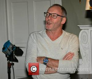 Liam Cunningham - Director Terry Gilliam is presented with a Jameson Dublin International Film Festival Volta Award by Liam Cunningham...