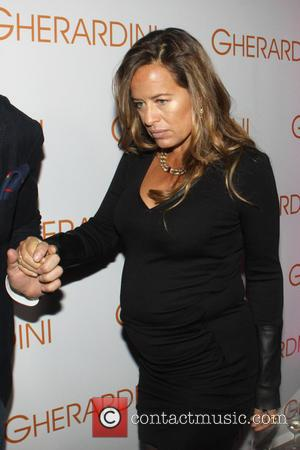 Jade Jagger - Pregnant Jade Jagger is the special guest at the opening of the new Gherardini boutique on Via...