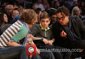 Johnny Galecki - Celebrities courtside at the Lakers game. The Los Angeles Lakers defeated the Boston Celtics by the score...