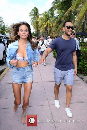 Christine Teigen and John Legend - Chefs and Sport Illustrator Swimwear Models Volleyball Tournament during the Food Network South Beach...